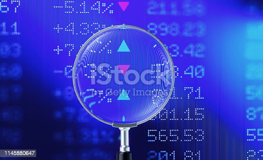 850495466 istock photo Magnifier Focusing On A Financial and Technical Data Analysis Graph 1145880647