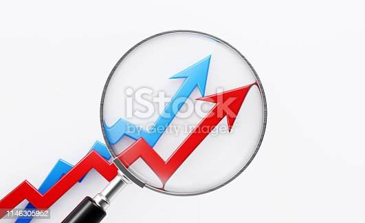 Magnifier focusing on a financial graph moving up. Selective focus. Horizontal composition with copy space.