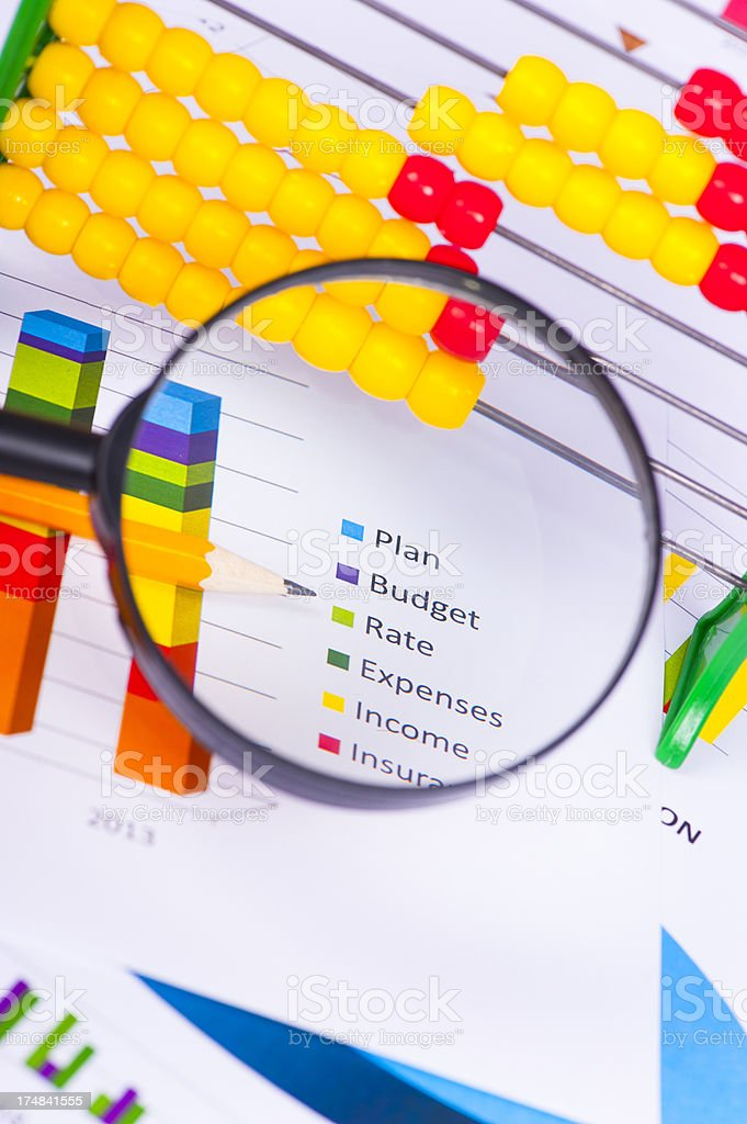 Magnifier glass with abacus royalty-free stock photo
