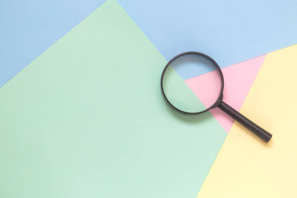 Magnifier on pastel background search minimalistic concept. stock photo