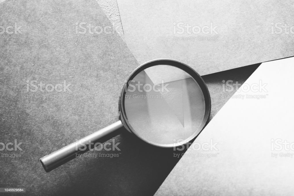 magnifier search seek look recruit grey paper stock photo