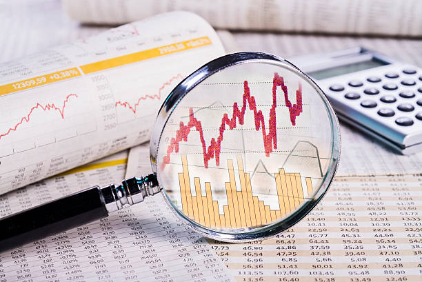 Magnifier with share prices stock photo