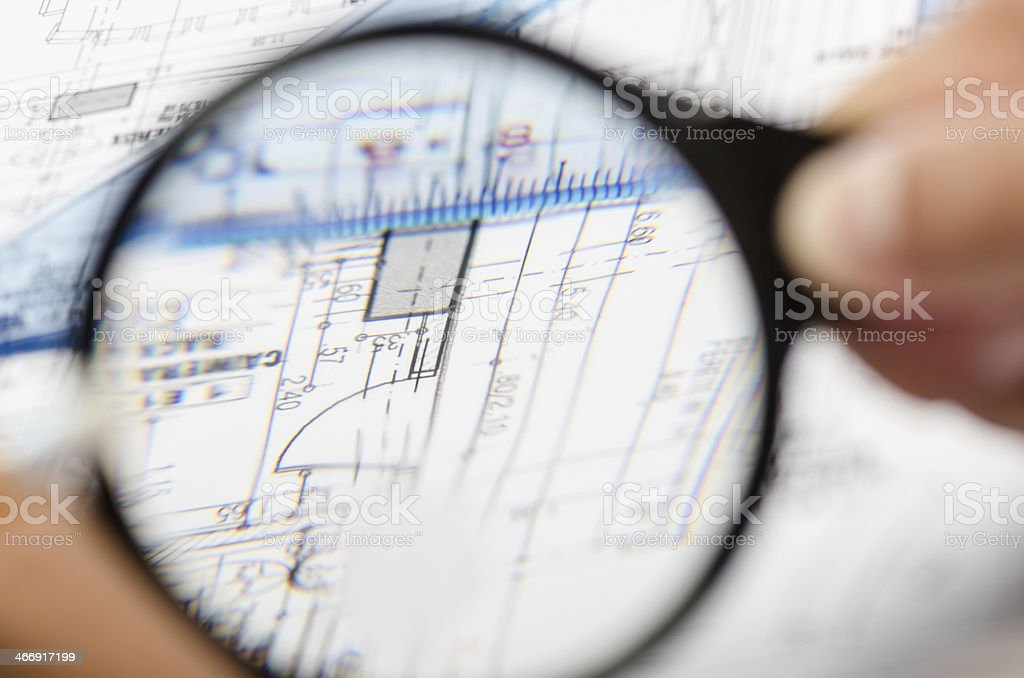Magnifing on blueprints royalty-free stock photo