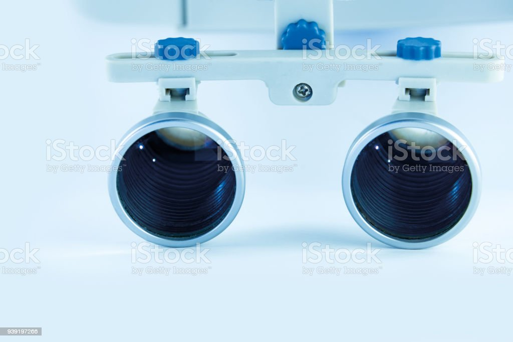 61161286995b Magnifying binocular glasses close-up. Dental instruments in the clinic.  The concept of new technologies in dental practice - Stock image .