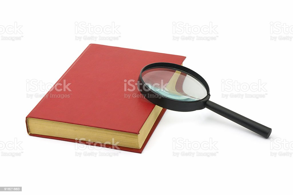 Magnifying glass and book royalty-free stock photo