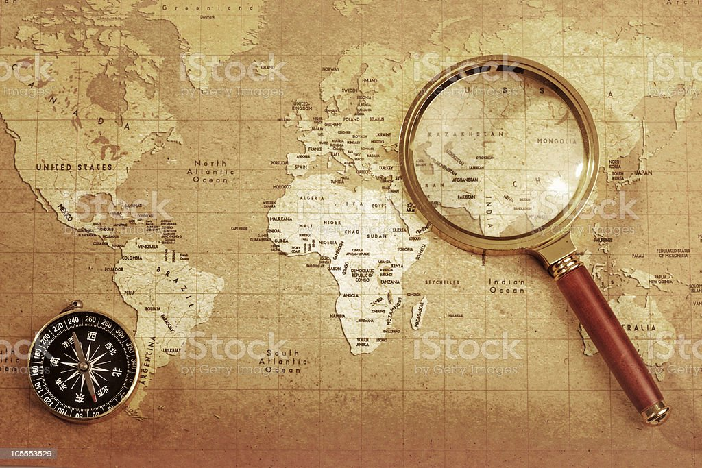 magnifying glass and compass on map royalty-free stock photo