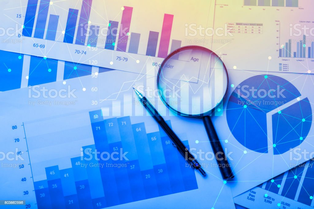 Magnifying glass and documents stock photo