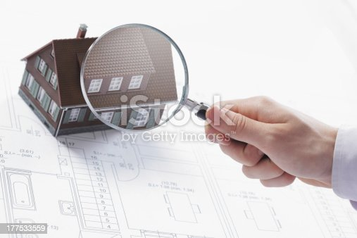istock Magnifying glass and house. 177533559
