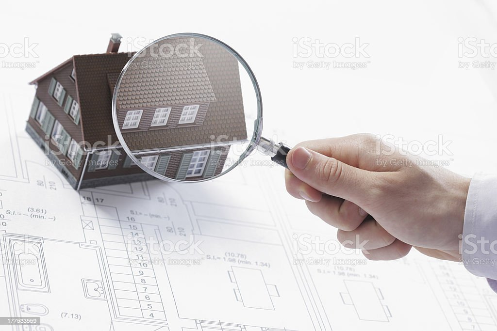 Magnifying glass and house. stock photo
