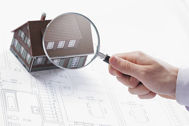 magnifying glass and house. - quality control stock photos and pictures