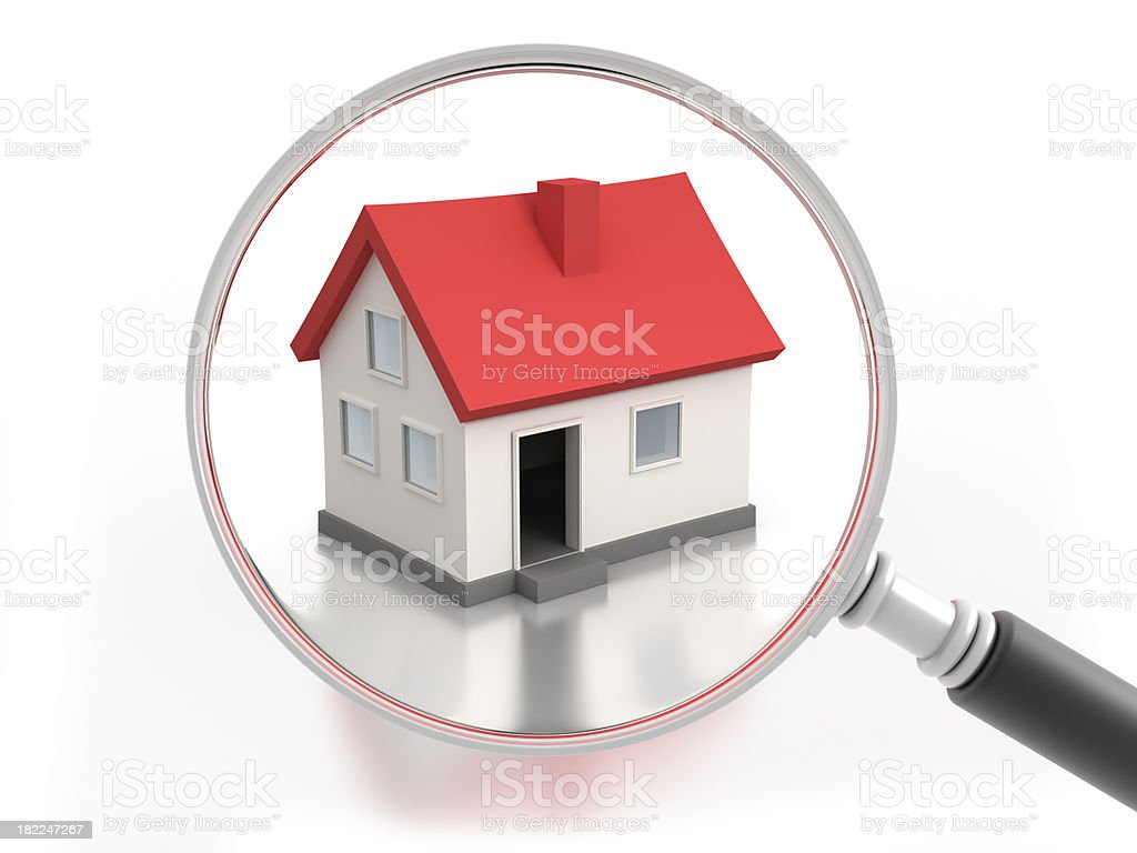 Magnifying glass and house with clipping path stock photo
