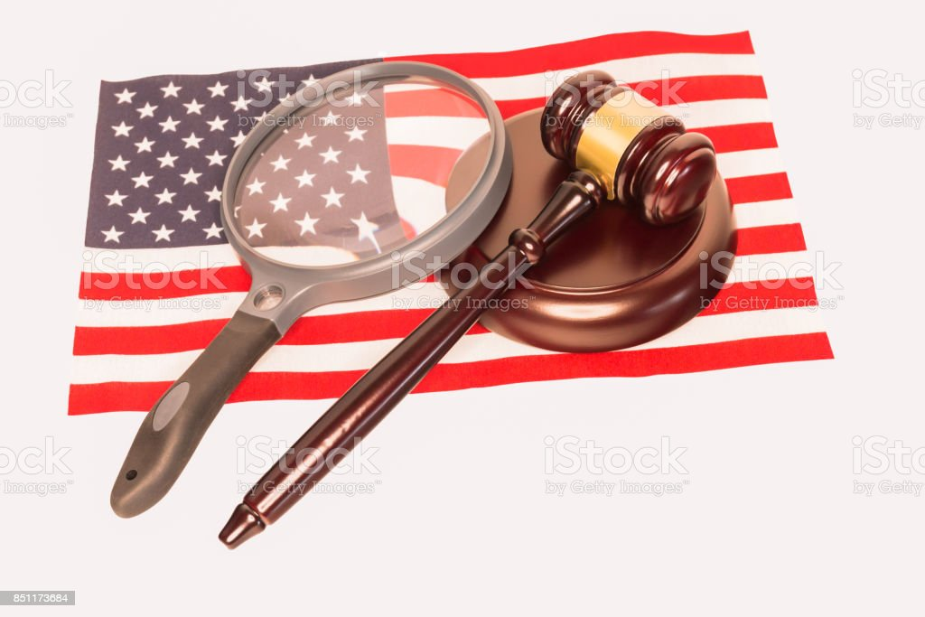 Magnifying Glass and Judges Gavel on The American Flag stock photo