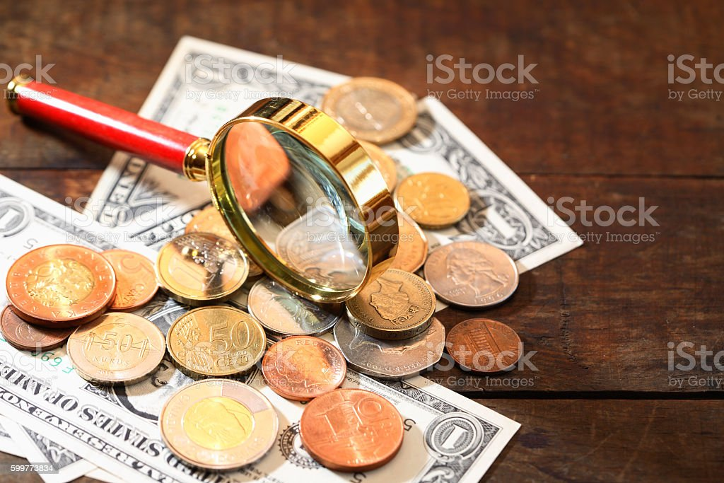 Magnifying Glass And Money stock photo