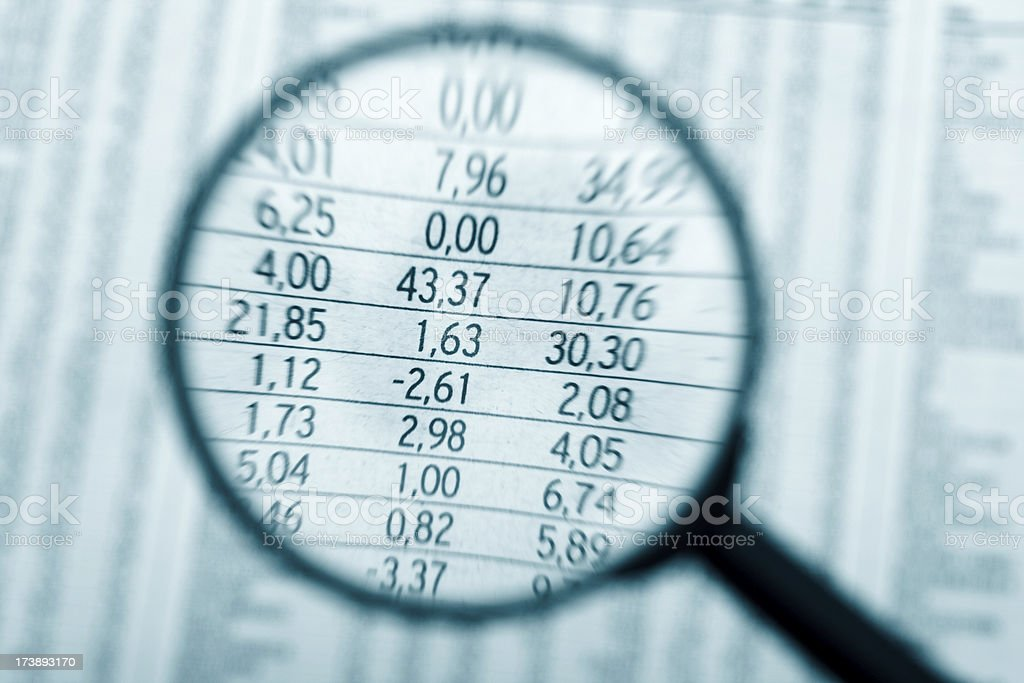 Magnifying glass and numbers stock photo