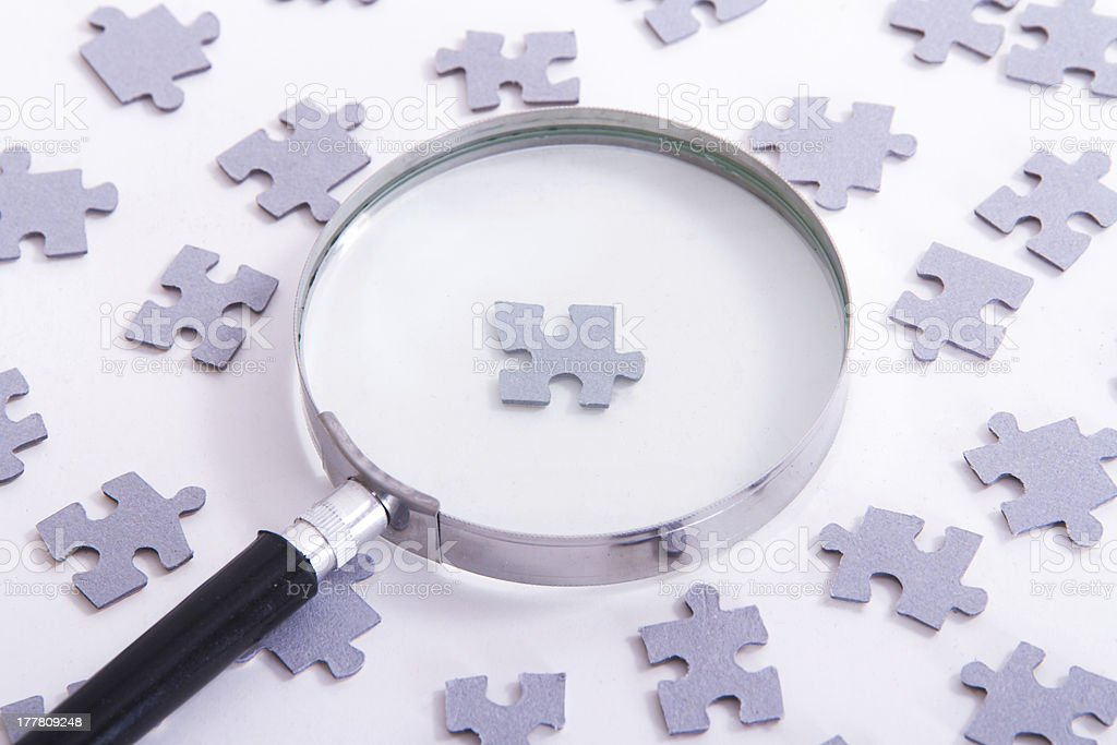 Magnifying Glass and Single Puzzle Piece royalty-free stock photo