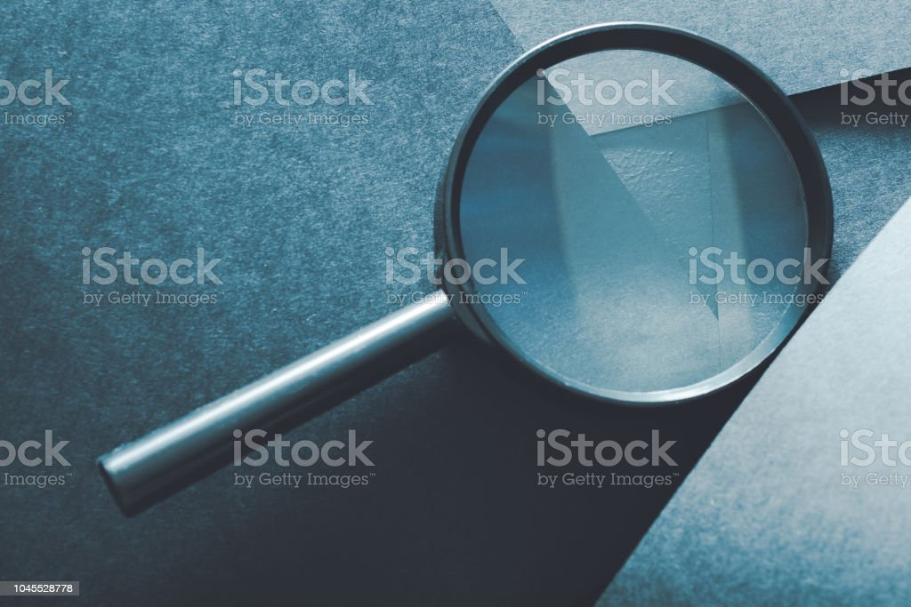 magnifying glass comparison assessment analysis stock photo