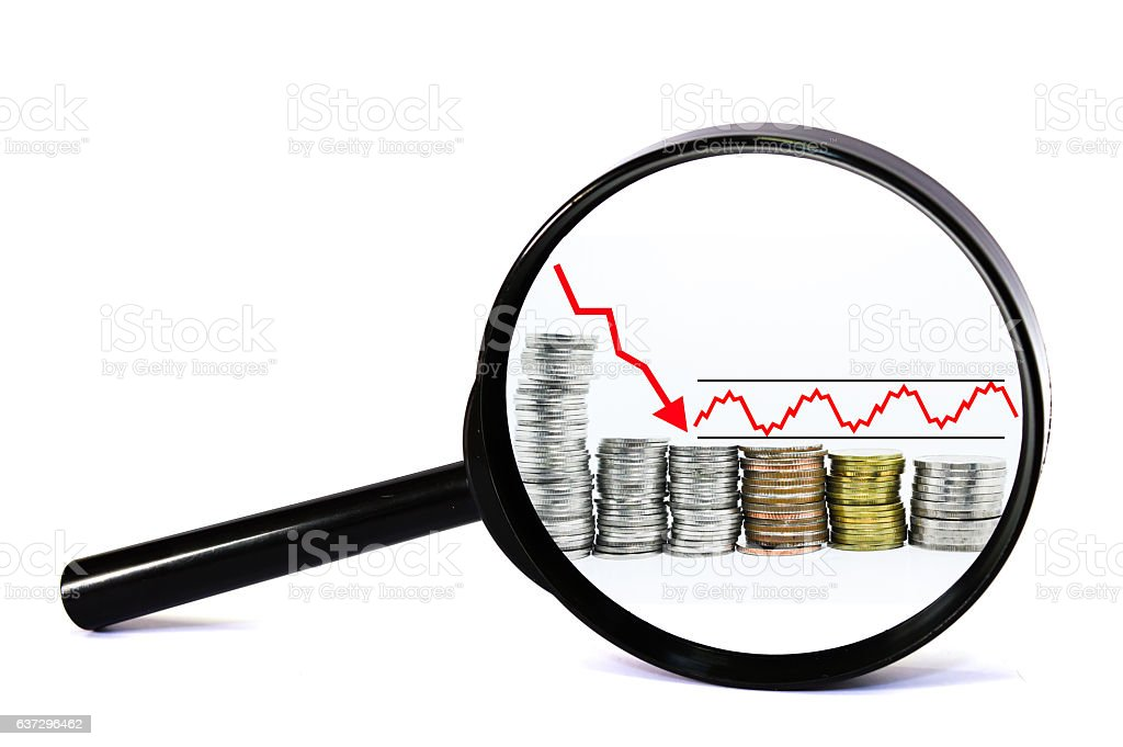magnifying glass concept red arrow downward on coin stock photo