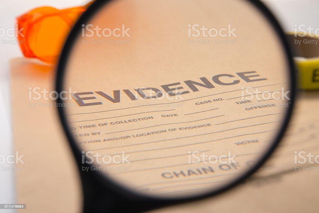 Lupe Fokus auf Beweismitteltüte – Foto