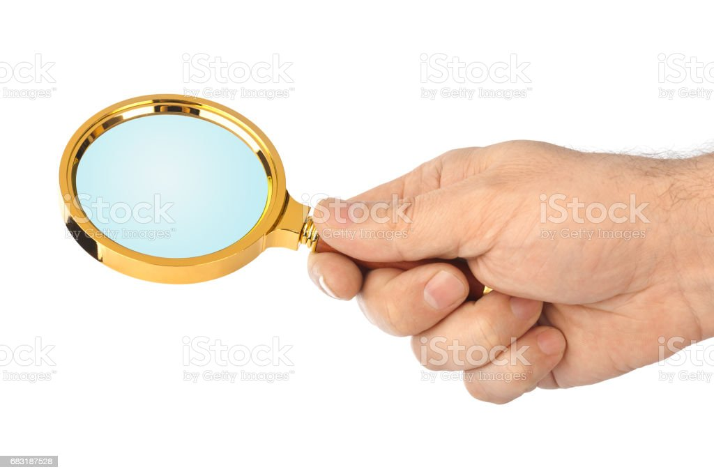 Magnifying glass in hand royalty-free 스톡 사진