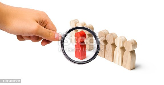 483424715 istock photo Magnifying glass is looking at the red figure of a man comes out of the line of people. Talent, leader, professional. improvement in work, the universal recognition of efficiency and leadership 1133450883