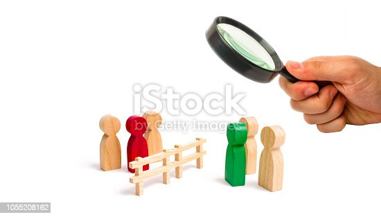 656916072istockphoto Magnifying glass is looking at the wooden fence divides the two groups discussing the case. Termination and breakdown of relations, breaking ties. Contract break, conflict of interests. 1055208162