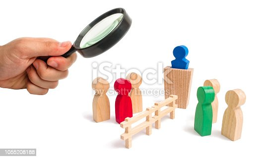 656916072istockphoto Magnifying glass is looking at the wooden fence divides the two groups discussing the case. Termination and breakdown of relations, breaking ties. Contract break, conflict of interests. 1055208188
