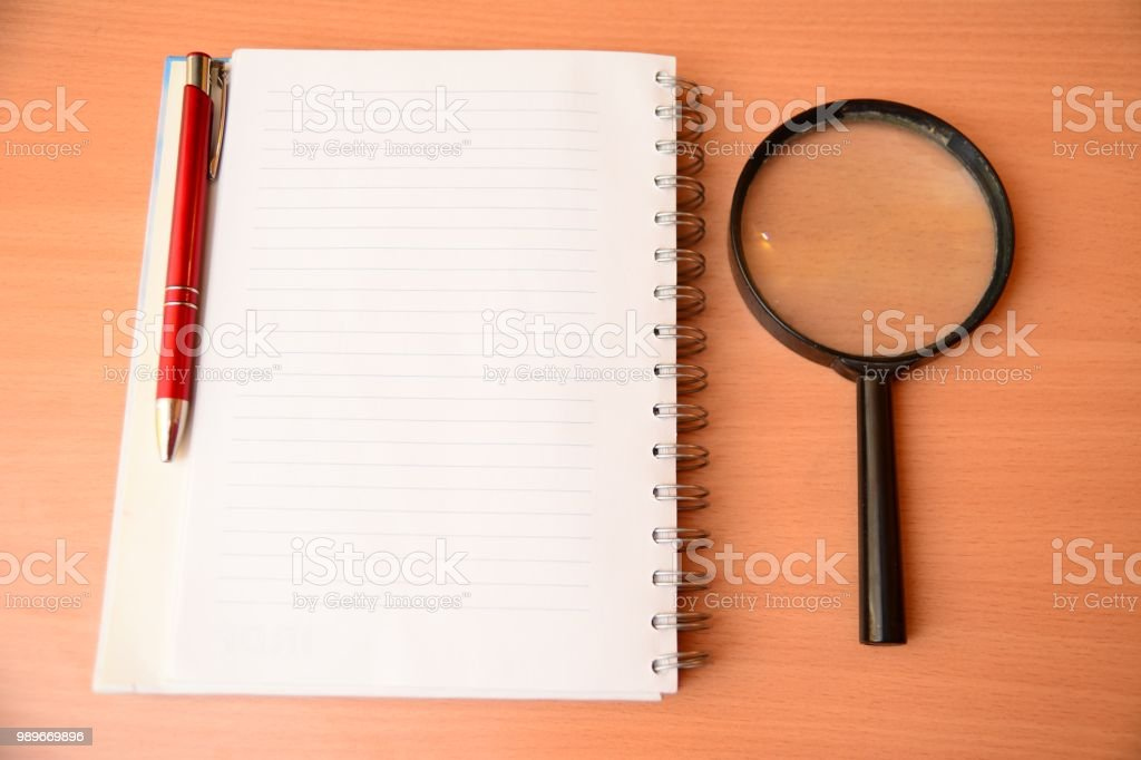 Magnifying Glass, Loupe, notepad stock photo