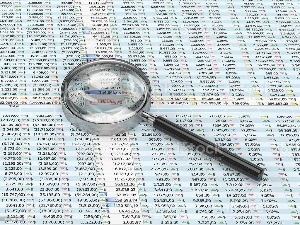 Magnifying glass on a spreadsheet royalty-free stock photo