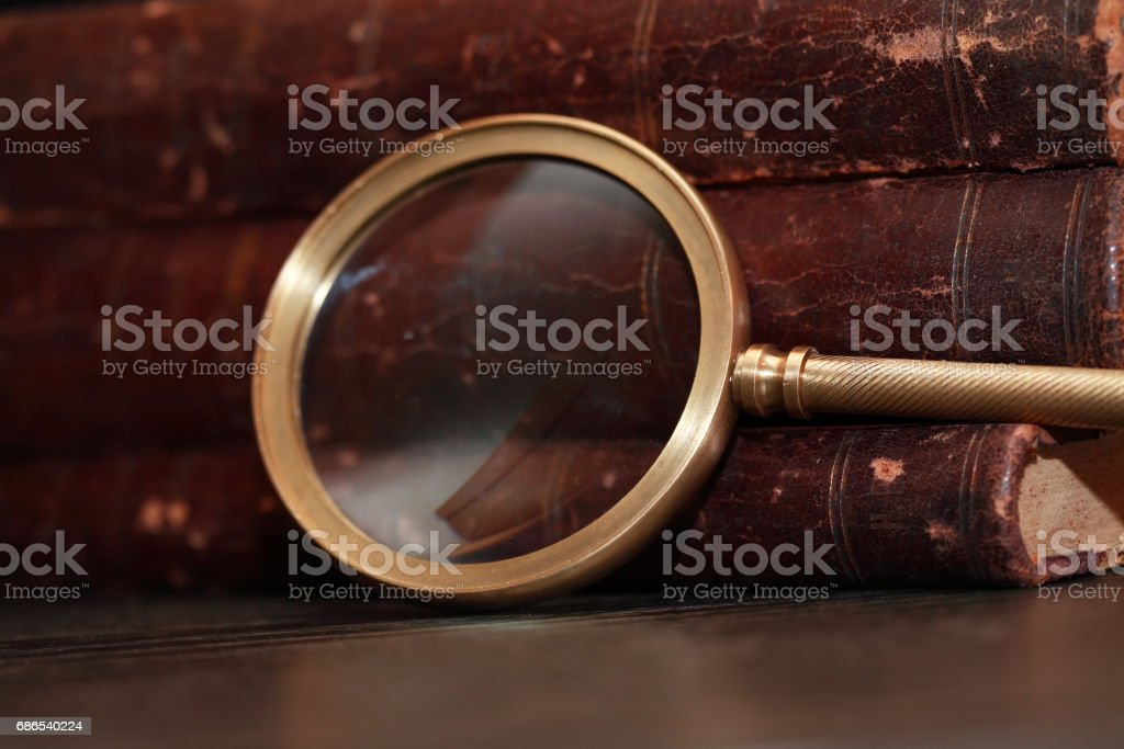 Magnifying Glass On Book stock photo