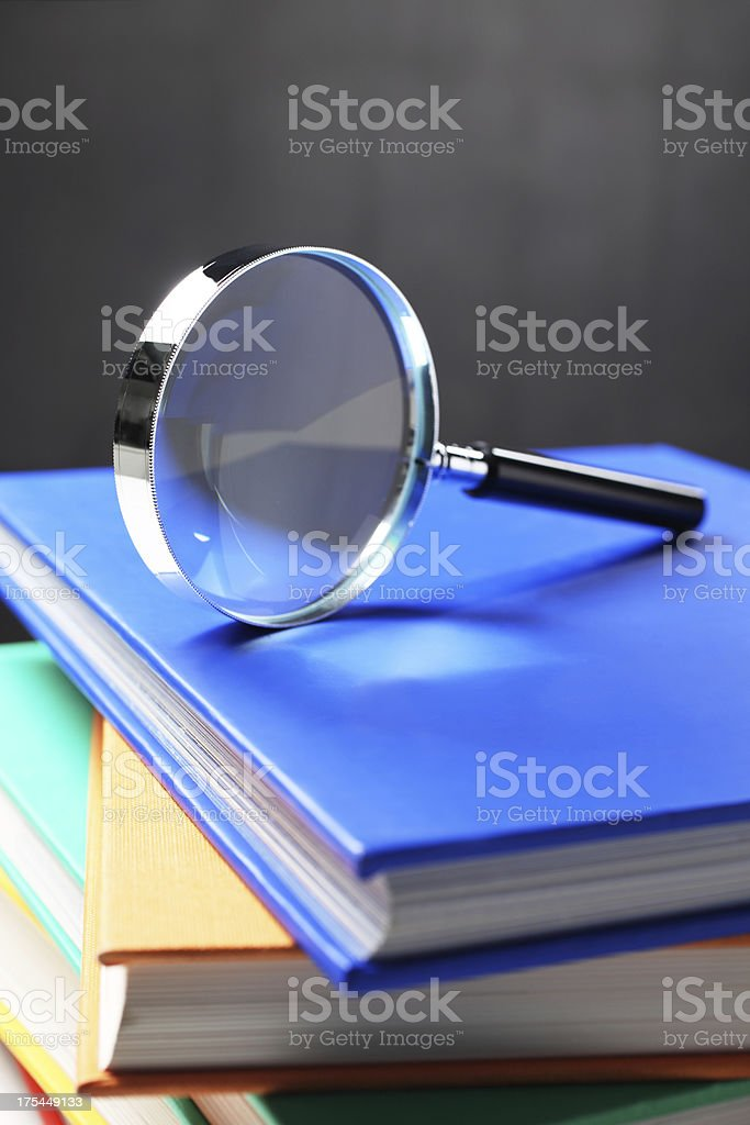 Magnifying Glass on Books royalty-free stock photo