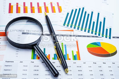 istock Magnifying glass on charts graphs spreadsheet paper. Financial development, Banking Account, Statistics, Investment Analytic research data economy, Stock exchange trading, Business office company meeting concept. 1146194839