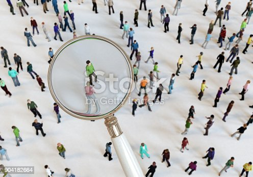 istock Magnifying Glass On Crowd of People 904182664