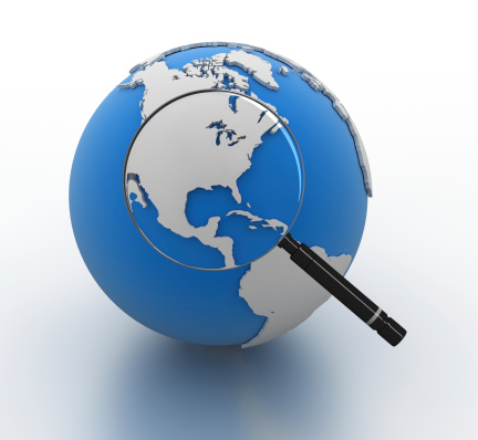 921148564 istock photo Magnifying Glass on Globe 149157500