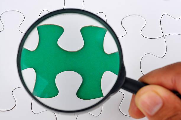 Lupe auf fehlende Puzzle – Foto