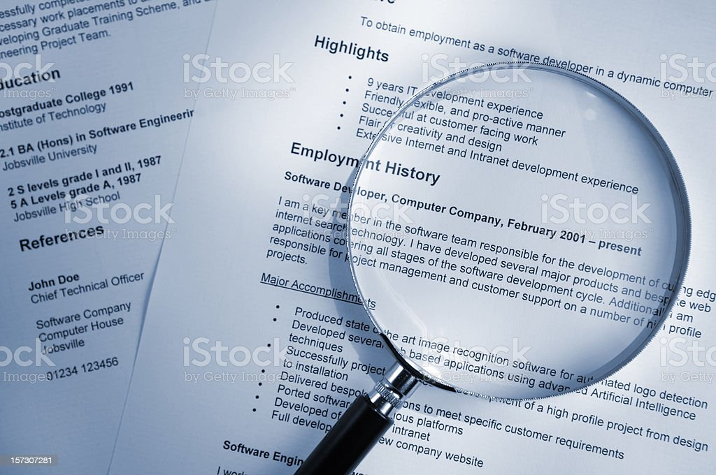 Magnifying Glass on Resume stock photo