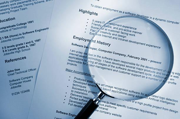 magnifying glass on resume - curriculum vitae bildbanksfoton och bilder