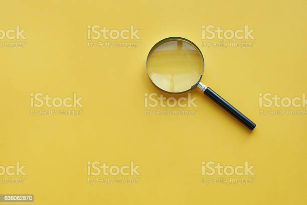 Magnifying glass on the orange background