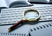 istock magnifying glass on the pc keyboard search technology concept 1141404963