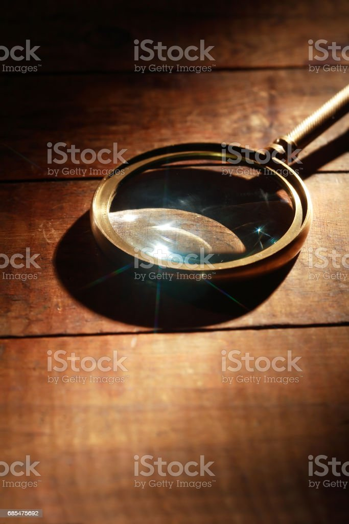 Magnifying Glass On Wood stock photo