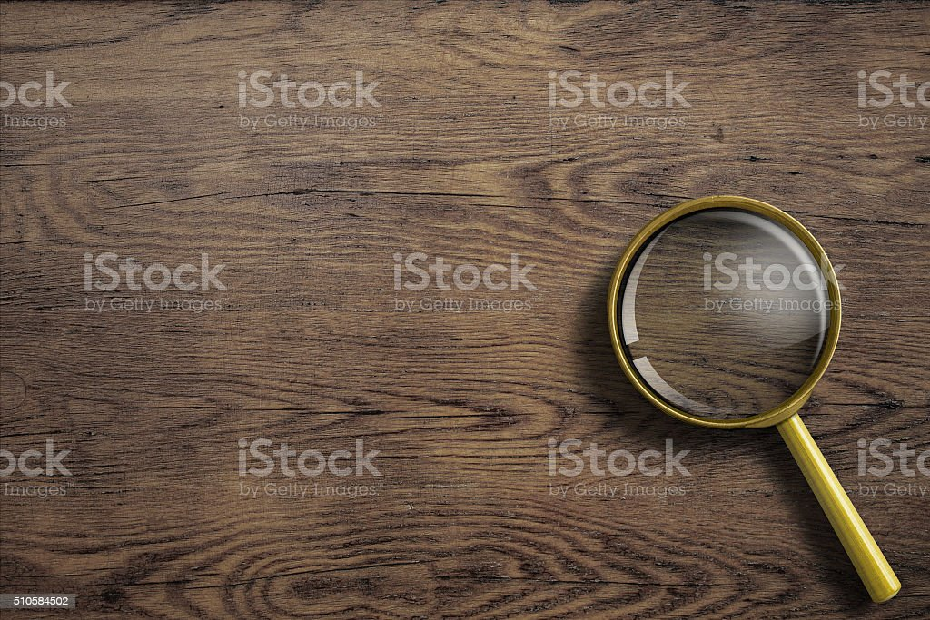 magnifying glass or loupe on wooden table stock photo