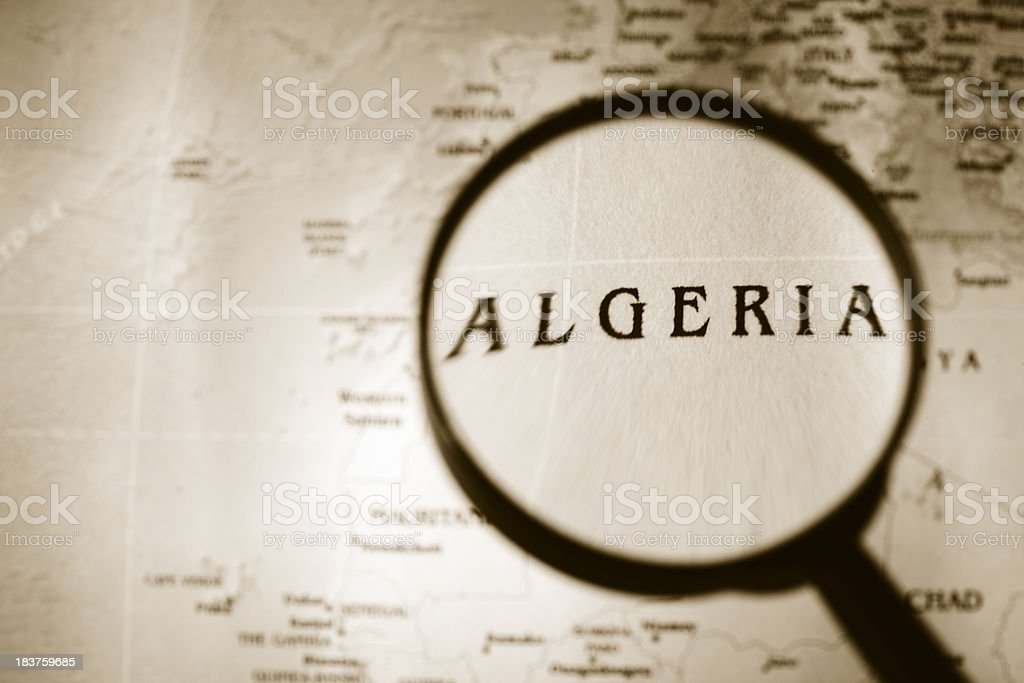 Magnifying glass over a map of Algeria. royalty-free stock photo