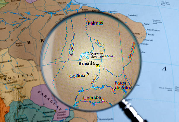 Magnifying glass over a map of BRAZIL close up of BRAZILthru a magnifying glass goiás city stock pictures, royalty-free photos & images