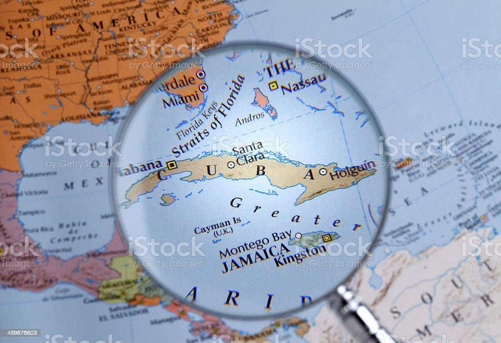 Magnifying glass over a map of CUBA stock photo