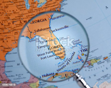 istock Magnifying glass over a map of FLORIDA 459676619