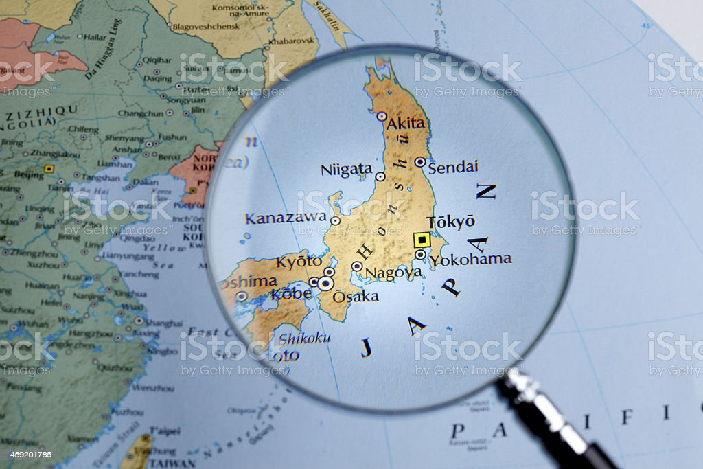 Magnifying glass over a map of Japan stock photo