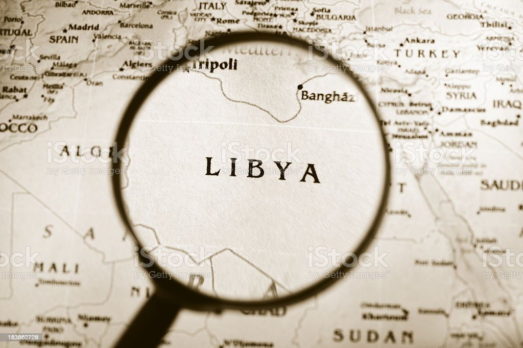 Magnifying glass over a map of Libya. stock photo