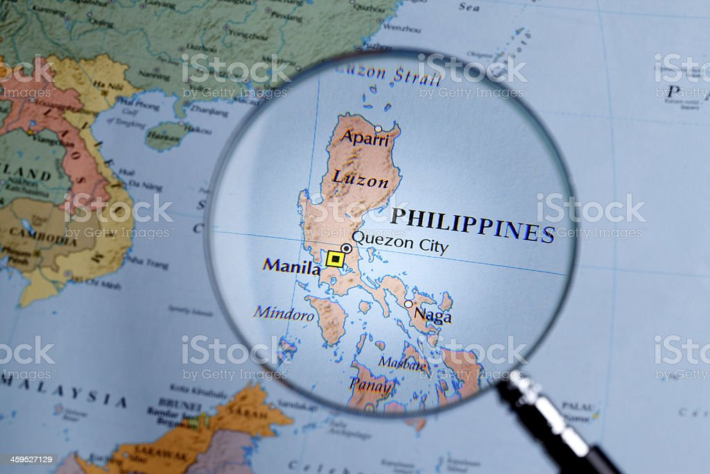 Magnifying glass over a map of Philippines stock photo