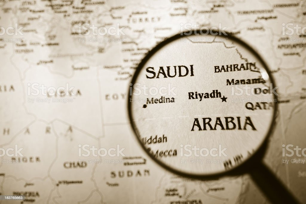 Magnifying glass over a map of Saudi Arabia. royalty-free stock photo