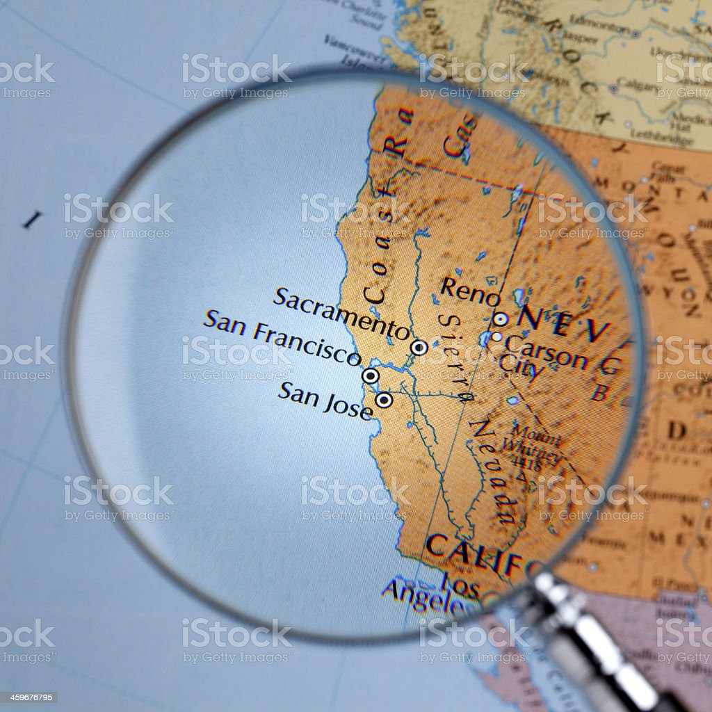 Magnifying glass over a map of West Coast stock photo