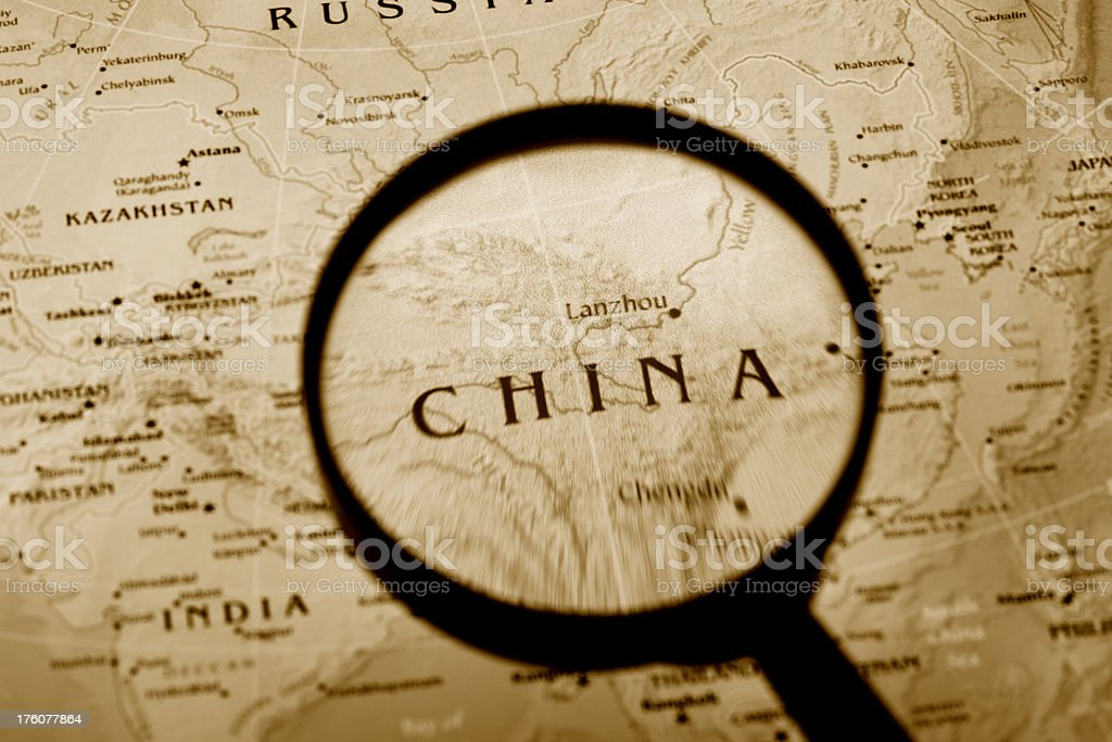 Magnifying glass over China in a map. (XXL) royalty-free stock photo